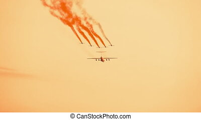 Armed russian fighter jets with smoke trail on the red...