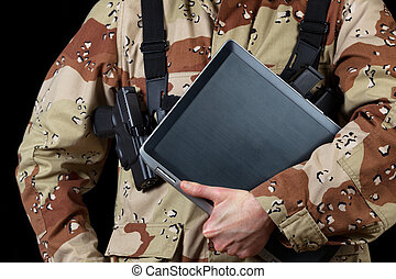 Armed soldier holding modern technology computer