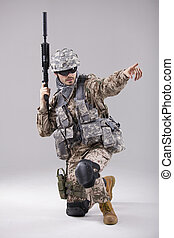 Armed Soldier pointing with finger