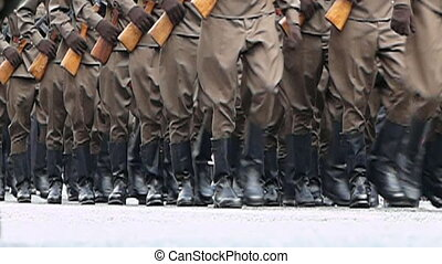 Armed soldiers march path