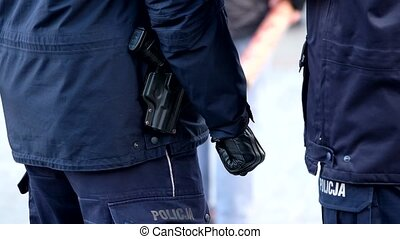Armed with a pistol police ready to use weapons - Armed with...