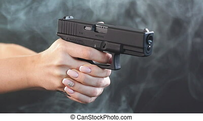 Armed woman shoots with gun at a target, Slow motion - Armed...