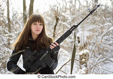 Armed young lady with a gun