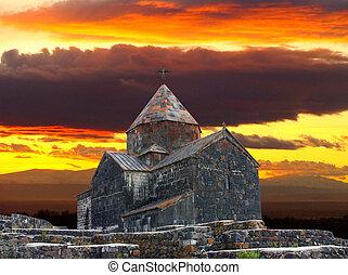 Armenian church on background of the sundown...