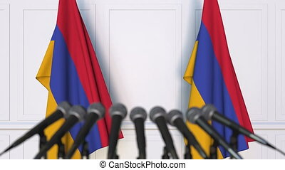Armenian official press conference. Flags of Armenia and...