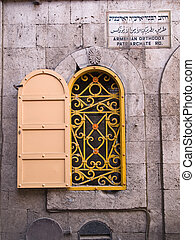Armenian orthodox patriarchate Street sign and a window Jerusalem Israel