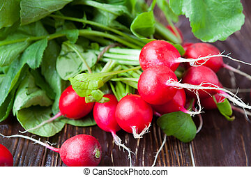 armful of fresh and juicy radish on the boards