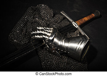 Armor and sword - Medieval chain mail, iron gauntlet and a ...