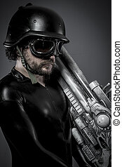 Armor. Starfighter with huge plasma rifle, fantasy concept, military helmet and goggles motorcyclist