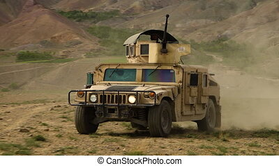 Armored military vehicle - A tracking shot of armored and...