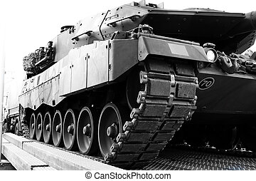 Close up side view of an armored tank vehicle.