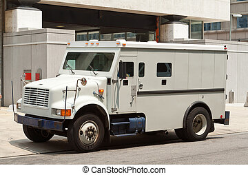 Armoured Armored Car Parked on Street Building - Side view...