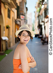 Arms crossed female - Smiling female wearing hat posing with...
