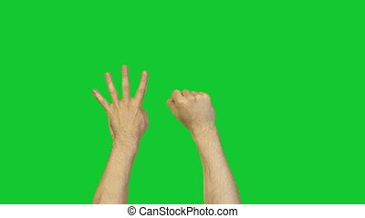 Arms in counting to ten on green background - Footage of...