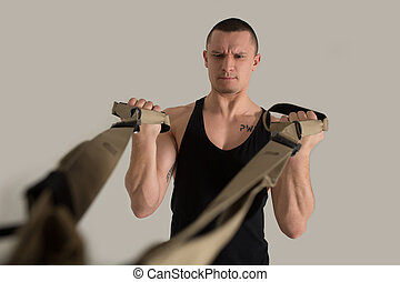 Arms muscles training on TRX bodybuilder