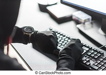 Arms of computer burglar noting down time