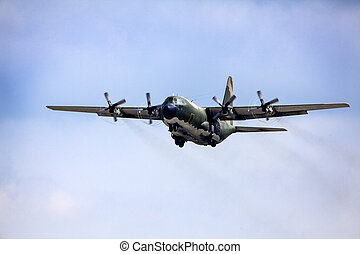 Army aircraft fly in blue sky