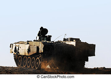 Army and Tank - Silhouette of an army soldier on a moving...