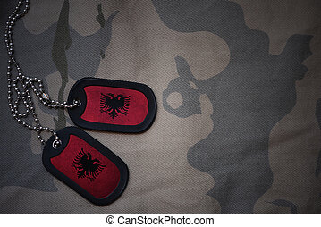 army blank, dog tag with flag of albania on the khaki texture background. military concept