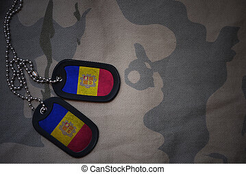 army blank, dog tag with flag of andorra on the khaki texture background. military concept