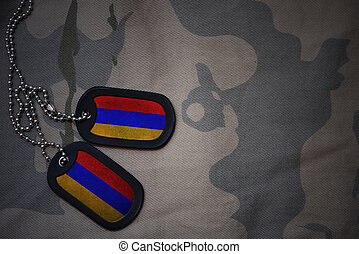army blank, dog tag with flag of armenia on the khaki texture background. military concept