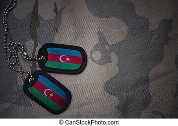 army blank, dog tag with flag of azerbaijan on the khaki texture background. military concept