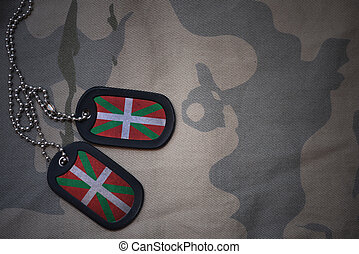 army blank, dog tag with flag of basque country on the khaki texture background. military concept