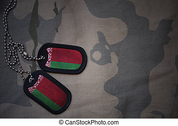 army blank, dog tag with flag of belarus on the khaki texture background. military concept