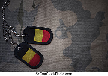 army blank, dog tag with flag of belgium on the khaki texture background. military concept