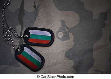 army blank, dog tag with flag of bulgaria on the khaki texture background. military concept