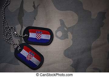 army blank, dog tag with flag of croatia on the khaki texture background. military concept