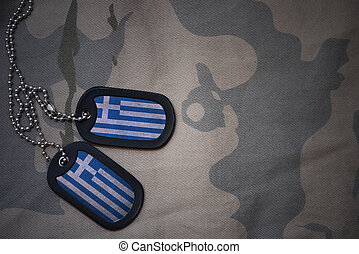 army blank, dog tag with flag of greece on the khaki texture background. military concept