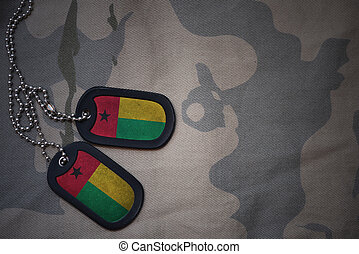 army blank, dog tag with flag of guinea bissau on the khaki...