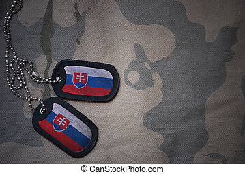 army blank, dog tag with flag of slovakia on the khaki...