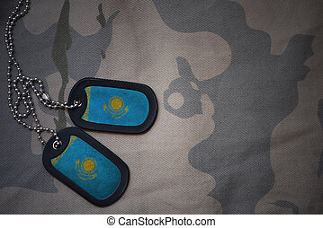 army blank, dog tag with flag of kazakhstan on the khaki...