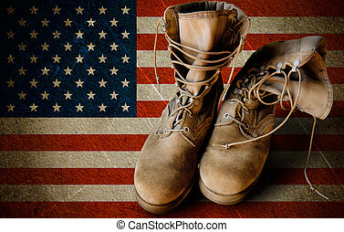 Army boots on sandy flag background - Grunge US Army boots...