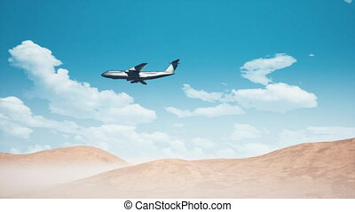 Army cargo aircraft flying low over sandy desert 4K
