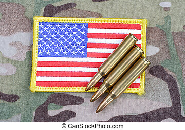 ARMY flag patch and 5.56 mm rounds on camouflage uniform