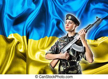 Army girl in military uniform on the Ukraininan flag...