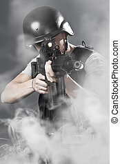 Army man over smoke background holding a machine gun