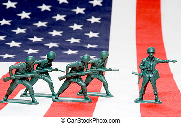 Army Men - A group of toy soldiers on an American flag.