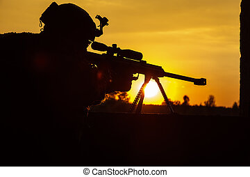Army sniper seeking enemy - Army sniper with large-caliber...