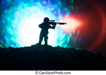 Army sniper with large-caliber sniper rifle seeking killing enemy. Silhouette on sky background. National security ensured, servicemen on guard