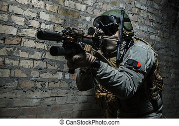 Army soldier aiming weapons