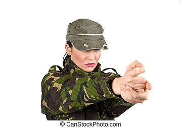 Army soldier gesturing with hands like he shoot with a gun...