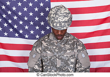 Army Soldier In Front Of American Flag