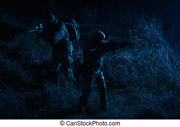 Army tactical group fighters sneaking in darkness