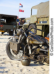 Army trucks and army motocycle on beach