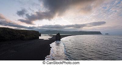 Arnardrangur stack - a tourist attraction in Iceland - View...