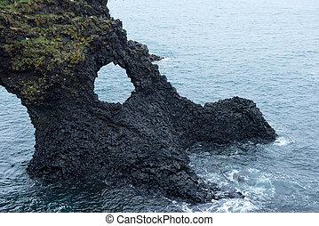 Arnarstapi basalt rock arch formation, Iceland